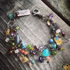 Gemstone Three Strand Bracelet Sterling Silver Handmade Wild Prairie Silver Jewelry Jeweled Bracelet ~ Beautiful array of gemstones…. multicolored sapphires, garnets, rubies, emeralds, amethyst, citrine, labradorite, appetite, moonstone, aquamarine. Hand made from sterling silver. It is very feminine and delicate but strong… Each strand is hand made, links hand made and hammered. Extension allows for adjusting the bracelet for the best size. If you have a wrist smaller than 6 inches or…