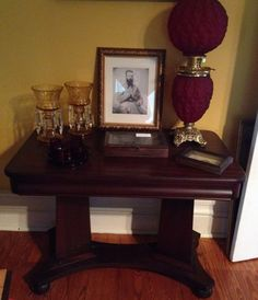 American Empire table, c. 1820,  in the library at Gregg-Hamilton.