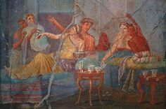 A group relaxes over a glass of wine in this Pompeian wall painting. Treasures like this give us a wonderful insight into what life was like before the town was devastated in AD 79. Taken from the West Wall of the Triclinium in the bakery of the house of the chaste lovers. Photo M Larvey