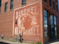 The ghost sign on the side of CHIPPEWA FALLS MAIN STREET at 514 N. Bridge St., Chippewa Falls, WI.