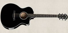 has crisp white binding on an all-black guitar body highlighting the contours of this eye-catching all-black 200 Series Grand Auditorium. Acoustic Guitar Tattoo, Black Acoustic Guitar, Guitar Diy, Guitar Songs, Guitar Tabs, Acoustic Guitars, Taylor Guitars, Best Guitar Players, Music Store