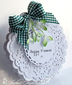 Christmas card ... round & layered ... cute sentiment for mistletoe ... luv the green checkered bow ...
