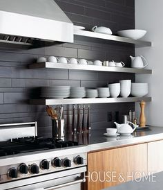 30 Kitchens That Dare To Bare All With Open Shelves Charcoal ceramic tiles, walnut cabinetry and stainless steel shelves are a winning trio in this stylish kitchen. Stylish Kitchen, Open Kitchen, Kitchen Backsplash, Black Backsplash, Backsplash Ideas, Country Kitchen, Kitchen Furniture, Kitchen Interior, Kitchen Decor