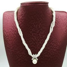 """⚪ Crystals ⚪ Simulated ⚪ Pearls ⚪ Necklace⚪ NWT Brand new with tags  Alloy metal closure Crystals Simulated Pearls Length: approx 17""""   NO TRADES   For more items please visit www.randomfindsboutique.com ☺   Jewelry Necklaces"""