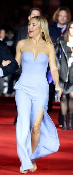Kate Hudson in a lavender wide-leg strapless jumpsuit with high slit