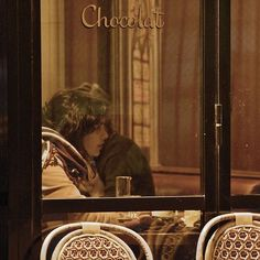 Woman in a cafe, Paris by diane.smith