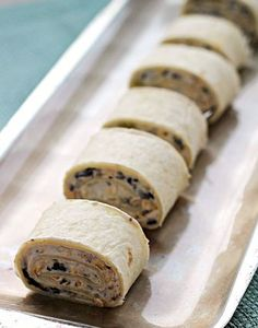 Tortilla Pinwheels ~ Bite sized bites stuffed with Black Olives, Green Chiles, Cheese and Cream Cheese! Use Ezekiel tortilla wraps to make these even better! Finger Food Appetizers, Yummy Appetizers, Appetizers For Party, Appetizer Recipes, Snack Recipes, Yummy Recipes, Cheese Appetizers, Tortilla Wraps, Tortilla Pinwheels