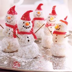 Roll pieces of marzipan into balls and dip them into confectioners' sugar; connect with toothpicks. Use marzipan dyed red to shape the hat and scarf and dyed orange for the nose. Finishing touches: brown toothpick arms and tiny chocolate chips for the eyes, mouth, and buttons.    Read more: Snowman Treats - Holiday Desserts Shaped Like Snowmen - Good Housekeeping