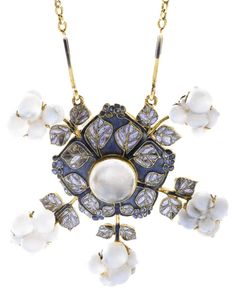 René Lalique - An Art Nouveau moonstone, enamel and glass pendent necklace, 'Snowberries', circa 1903. The pendant of snowflake and foliate design, applied with blue enamel, set with a cabochon moonstone and decorated with glass berry motifs, the chain composed of enamelled rods and gold links, length approximately 420mm, signed Lalique. #Lalique #ArtNouveau #necklace