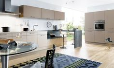 One of our Schuller kitchens with truffle brown kitchen cabinets and built in Neff slide away oven