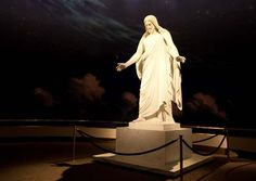 Statue of the Savior with a mural of the universe behind.  This is in the Visitors center on Temple Square