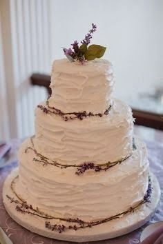 simple homemade wedding cake 2014 // i like the messy frosting on this style of cake. simple and interesting.