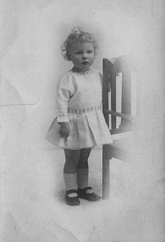 Baby girl in short dress black and white postcard pictures