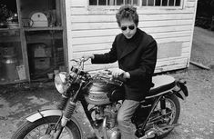 Bob Dylan on Triumph, behind Cafe Espresso, Woodstock, NY