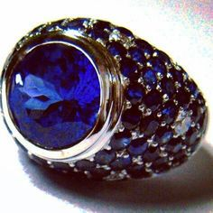 For those with the blues, this might help...Tanzanite statement ring in a ball of Sapphires & Diamonds. www.johnmeierfinejewelry.com