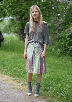 """I am wearing a self made 10 minute sequin skirt, men's socks, worn out boyfriend's t-shirt and customized heels. I'm inspired by my friends and people around me and the clothes I design. I like to feel comfortable in something I first find ugly."""