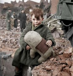 15 Remarkable Colorized Photos Will Let You Relive History  Abandoned boy holding a stuffed toy animal. London 1945