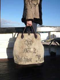 Using vintage sacks, Tamara Fogle fashions rather special bags, exquisitely finished with superb leather.