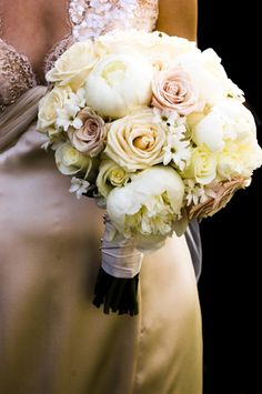 This looks like all roses..., Red & White roses plus some litte white flowers? This boquet is just stunning