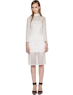 """All white everything is a major trend this summer. Rock the trend under the night sky in this chic cotton lace midi dress featuring cut-out detailing all over. It has a high collar and white slip layered inside. Style this white midi dress up with classy black pumps and box clutch to complete the look. By Sister Jane. *100% Cotton*30""""/76cm Bust ,28""""/71cm Waist ,41""""/104cm Length*Model is wearing size small and model's height is 5'10""""/178cm."""
