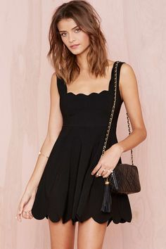 scalloped little black dress.