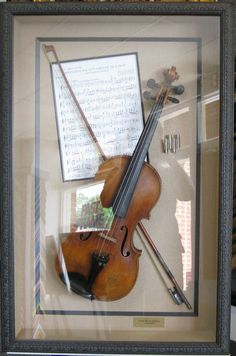 Nice way to display a keepsake my husbands grandfathers old violin framing isnt always a canvas or photograph it can be something very special ccuart Image collections