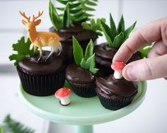 Learn how to make this nature-inspired Cupcake Terrarium with step-by-step tutorial. A little edible landscape filled with leaves, petite mushrooms and novelty deer. By Cakegirls for TheCakeBlog.com.