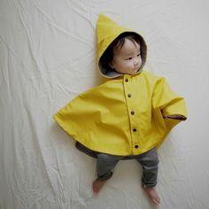 Baby Rain Cape ^ Petit Bateau  http://www.petit-bateau.co.uk/e-shop/product/12998/6X8/baby-rain-cape.html