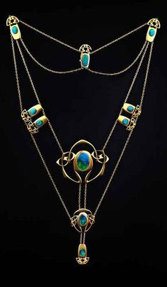Archibald Knox for Liberty & Co. An important Arts and Crafts gold and enamel necklace, circa 1900-1904. With individually shaped Celtic sinuous entrelac panels connected by trace-link chain swags in fitted case, the silk signed Liberty & Co Ltd., Regent St, London. Total length of pendant drop 11.7cm. #Knox #Liberty #ArtsAndCrafts