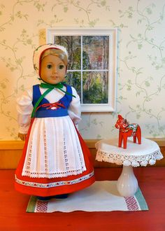 American Girl, 18 inch doll clothes:  Reserved for a special customer.  Dress and accessories in the tradition of Swedish folkwear, via Etsy. By Calyxadollcreations.