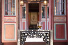 Whisky tasting with Copita glass in Chinese garden.  Spirit tasting in orient manner.