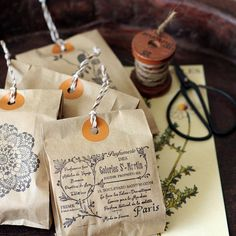 Pretty, and would be easy, inexpensive, and not time consuming if you had your own stamp (or stamps) made.