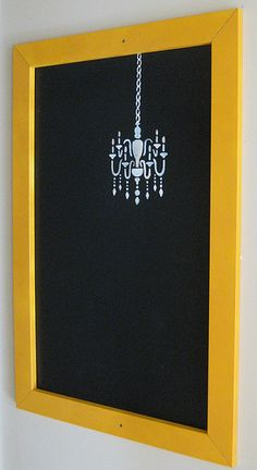 Whiteboard upcycled to blackboard with stencilling.  This would be fabulous with a fancy turquoise frame!