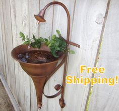 Faucet Spout Sconce SOLAR Water Fountain - Outdoor Water Fountain- Free Shipping. $79.00, via Etsy.