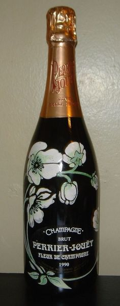 """1990 Perrier Jouet Fleur De Champagne Hand Painted Bottle Full MINT New Sealed  #PerrierJouet In true romantic fashion, Fleur de Champagne  One half of the blend is Chardonnay of surpassing finesse and delicacy. The other half is Pinot Noir of noble richness and complexity. A Champagne of ravishing fragrance and style, offered in the famous """"Flower Bottle"""". Wonderful Champagne and a beautiful package"""
