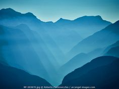 www.arcangel.com - scenic-view-of-distant-mountain-tops-in-a-hazy