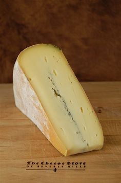 Morbier -  France. A semi soft cow milk cheese has distinctive line that runs through its center w/ no taste associated w/ this marking. Pungent aroma, taste mild but not tame. Creamy w/ a nutty albeit bitter aftertaste.