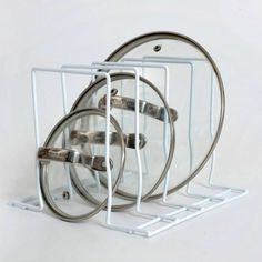 Use the pot lid rack to organise your pot lids. metal rack to organise kitchen cupboards. Pot Lid Organization, Kitchen Cupboard Organization, Kitchen Cupboards, Pot Hanger, Metal Rack, Plate Racks, Organic Architecture, Pot Lids, Updated Kitchen