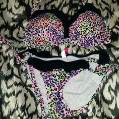NWOT VS leopard bikini NWOT Victoria's Secret leopard print bikini. Never been worn since it is too small! Still has the hygenic liner in the bottoms. Small bottoms, 34C push up bra top. Victoria's Secret Jackets & Coats