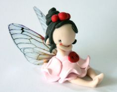 Fairy Figurine in a flower pot por TheDollAndThePea en Etsy