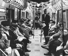 NYC subway car, c. 1967. Doesn't even seem possible people used to dress this way.