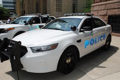 Cincinnati police showcased two of the new vehicles acquired by the department--the Ford Police Utility Vehicle (PUV) and the Ford Interceptor sedan--Thursday afternoon outside City Hall.  The PUV is based on the Ford Explorer and the sedan is based on the Taurus.  Of course, both vehicles have been upgraded for police use with accessories such as special seating, bars on the rear windows, light bars on the roof, computers and communication equipment.