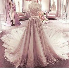 This heavily embellished ball gown would be beautiful for the mothers of the wedding. We can take haute couture #eveningdresses like this and create #replicas that look similar but are less expensive. For more info on custom #motherofthebridedresses or replicas contact us at buff.ly/B72gtj30