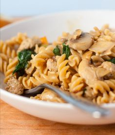 Traditional Italian Pasta with Sausage, Mushrooms and Spinach (Pasta con Salsiccia, Funghi e Spinaci) | Enjoy this authentic Italian recipe from our kitchen to yours. Buon Appetito!
