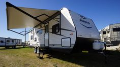 """PERFECT FAMILY-FRIENDLY RV!!!  2017 Jayco Jay Flight SLX 267BHSW Bring the whole family together in this 30' 2"""" long, 5615 lbs. travel trailer which sleeps up to 10 campers! Bask in the warm sunshine that radiates from the bathroom skylight! Lounge in the shade beneath your sprawling outdoor awning. Dine where you please with the indoor/outdoor dinette table!  Give our Jay Flight SLX expert Joe Benedict a call 231-286-3233 for pricing and more information."""