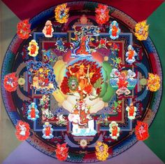 The Mandala of Dorje Shugden with his give families, nine mothers, right guiding monks, and ten youthful and wrathful attendants...