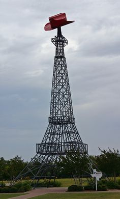 The Eiffel Tower in Paris, TX, topped off with a huge cowboy hat.