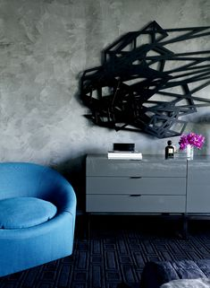 Love That Black Art And The Blue Chair With Grey