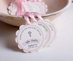 These personalized with name and date tags make the perfect finish to your gifts on your childs Religious celebration They are double layered and printed on rough creamy cardstock with beautiful typo and baby pink border. Each tag measure app. 2 2/3 in diameter and is coming with app. 12 luxorious ribbon in baby pink color (2 parts of 12), long enough to tie a beautiful bow around your gift.  DELIVERY INFORMATION (this does NOT include time needed to create your order) USA: 5 business days…