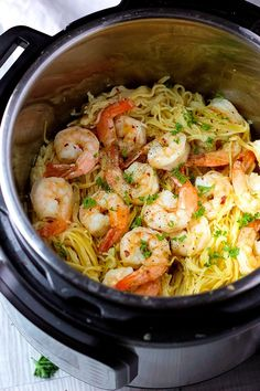 3-minute Instant Pot Shrimp Scampi with angel hair pasta, cooked in a fragrant shallot-wine broth, topped with capers and fresh parsley!